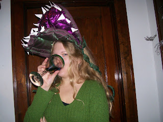 me, wearing a venus flytrap costume and drinking a glassof wine