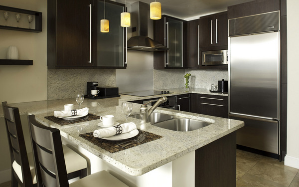 Modern-interior-design-small-compact-kitchen-with-black-kitchen-cabinets-modern-sink-kitchen-appliances-and-kitchen-furniture