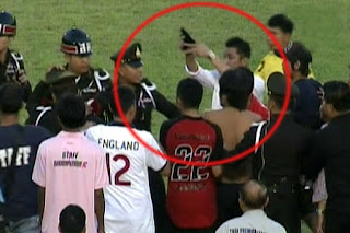 Soccer fan in Thailad pulls a gun on a referee
