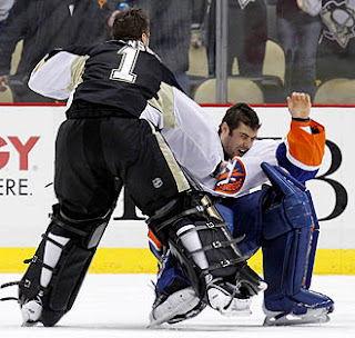 Pittsburgh Penguins' Brent Johnson knocks out New York Islanders' Rick DiPietro