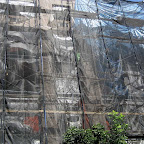 Trash Bag Camouflage - Shiny black veil, tarps and scaffolding on Berry in Williamsburg.
