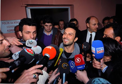 Turkish pop singer Tarkan speaks to the media after his release outside a courthouse in Istanbul, Turkey, Monday, March 1, 2010. Turkish police detained Tarkan, the country's best-known pop star, in a narcotics raid Friday in Istanbul along with nine other people. Tarkan, who only uses one name, and others were detained for their alleged links with two drug dealers being monitored by narcotics agents, the state-run Anatolia news agency said. Police reportedly found and seized a small amount of hashish at the pop star's country home in the Omerli district near Istanbul, the agency said. (AP Photo)