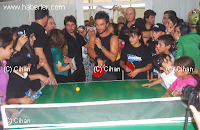 Tarkan visited a special school that provides sports, educational and cultural facilities for local children and spent the day with them, including playing a game of ping-pong