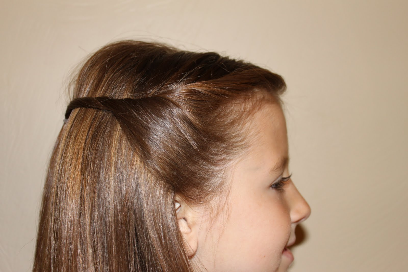 hairstyles for girls.. the wright hair: sides pulled back with twist