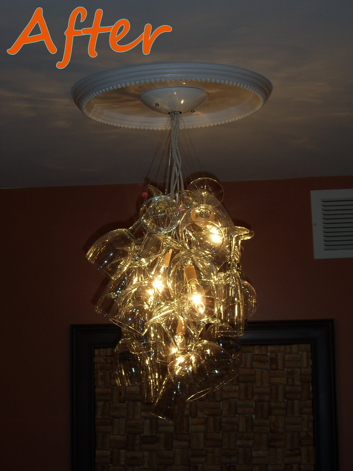 Remodelaholic diy wine glass chandelier guest project with the lights dimmed down aloadofball Choice Image