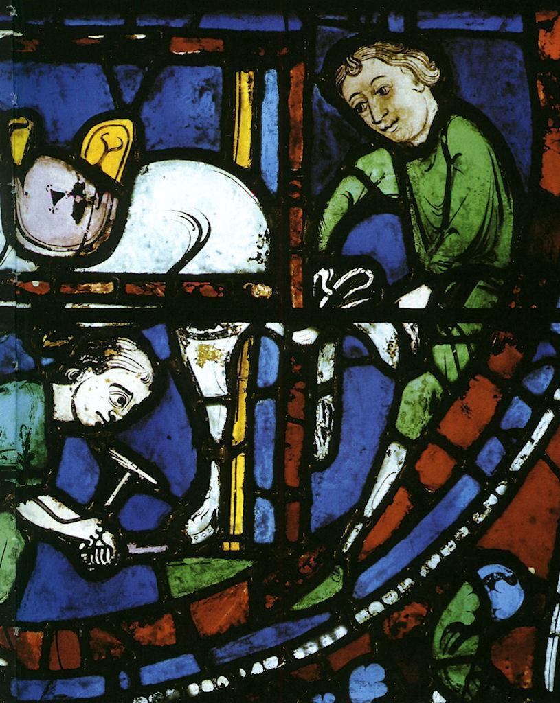 Ferreiros medievais. Vitral da catedral de Chartres, França.