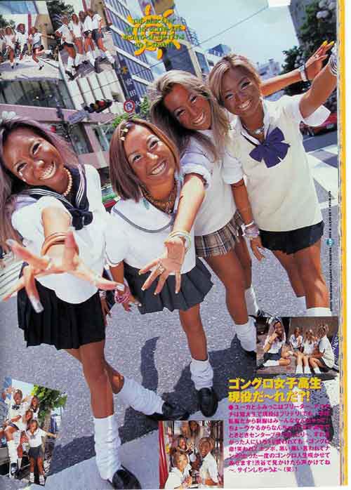 Japanese gyaru schoolgirls with tan skin and makeup showing - 2 2