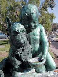 Boy with Dog Bronze Statue at Jahraus Park in Laguna Beach, CA