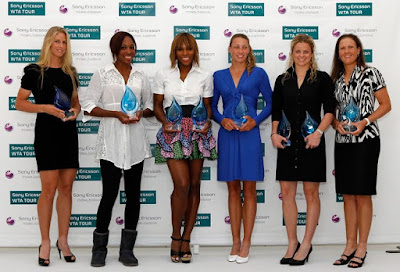 Black Tennis Pro's Venus and Serena Williams pose with other WTA player award recipients.