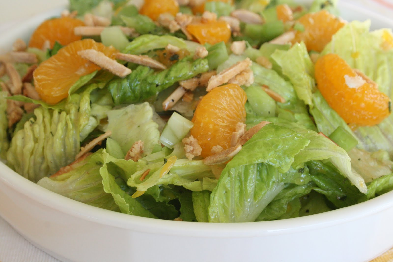 This MANDARIN ORANGE SALAD with ALMONDS AND CIDER VINAIGRETTE has been a favorite in our family forever! SO flavorful and easy Such a great salad to throw