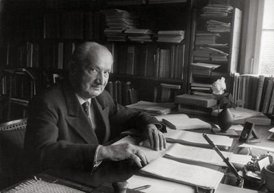 Philosopher Martin Heidegger, sitting at his desk