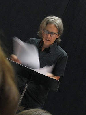 Eileen Myles reading at a lectern