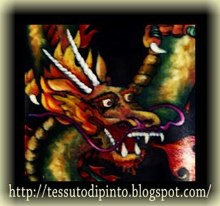 Particolare del drago dipinto su pelle vera con colori a solvente