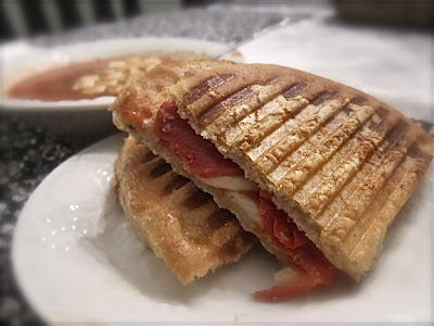 Turn a boring sandwich into a delicious meal with this easy Pizza Panini! You only need four ingredients to make this fun and flavorful meal. #WomenLivingWell #sandwiches #Italian #easymeals