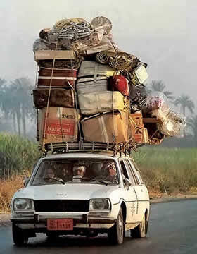 car driven with Excess Load above it (24) 2
