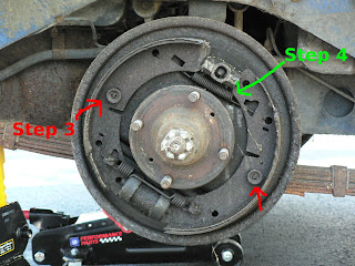S L in addition A further Dsc likewise Ab B Db as well C. on rear brake shoe spring