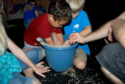 fall party game hide pennies in corn cob filled bucket