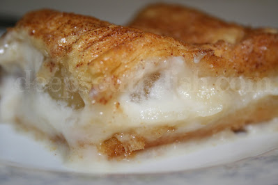 Pie filling, in this case apple, is sandwiched between layers of crescent dough and a bottom layer of sweetened cream cheese, topped with cinnamon sugar. Just delicious and so easy.