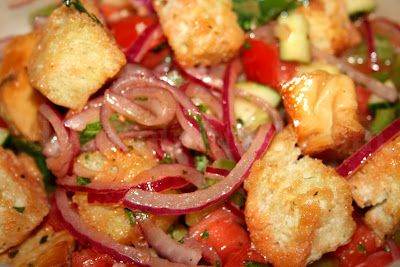 Panzanella salad may not be a traditional southern dish, but it sure fits in with our hot summer days and you don't even have to turn the oven on for homemade croutons - just grill your bread instead!