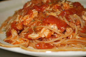 A fresh homemade tomato sauce and a whole cooked hen make for one of my favorite spaghetti dishes in memory of my grandma.