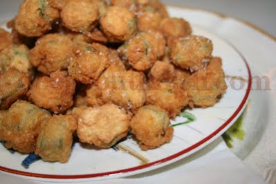 Sliced okra is dipped in buttermilk and then dredged in a lightly seasoned mixture of cornmeal and flour, then deep fried to crispy perfection.