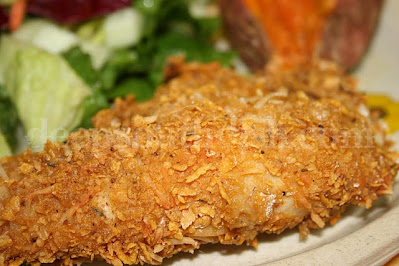 A crunchy crispy oven fried chicken that starts with a buttermilk, lemon and mustard marinade and is finished with a cornflake, Parmesan herb crusting.