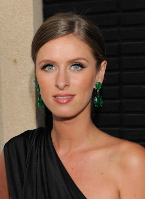 b4c15aa63 Jewelry hounds, I need your peepers. Is it me or is Nicky Hilton wearing  THE SAME emerald earrings that Angelina Jolie made famous at the Oscars  this year?