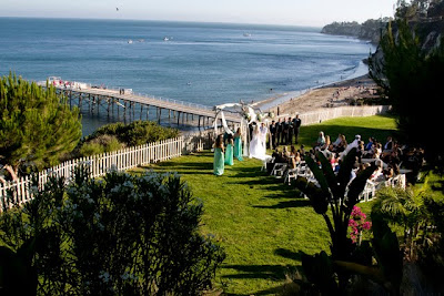 The Ceremony Was Held Up On A Bluff Overlooking Beach And Pier
