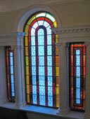 stained glass over staircase