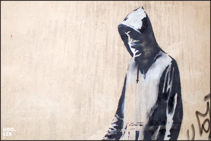 Banksy Hoodie Stencil Walking dog in South London.