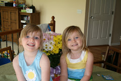 My silly girls and a pot of daisies!