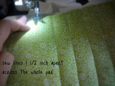 A sewing machine sewing a hot pad with instruction on how to sew it.