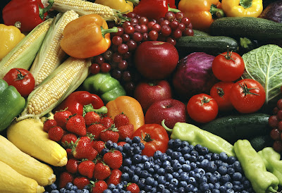 A collection of fresh fruit and uncooked vegetables