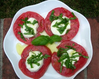 Insalata Caprese, the summer classic, just slices of perfect tomato and fresh mozzarella
