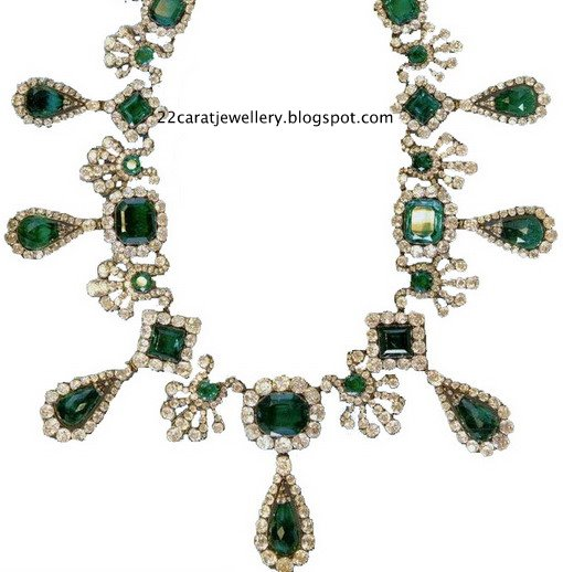 Diamond Necklace with Emralds at Tanishq Jewellers Show Room