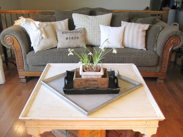 white coffee table and pillows via Funky Junk Interiors