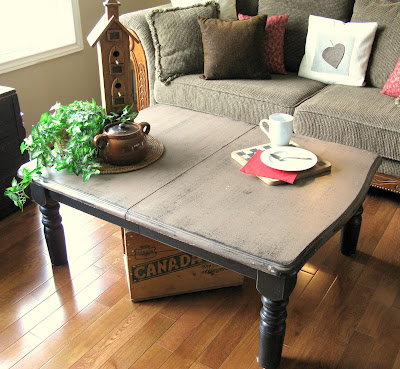 Learn how I flipped a kitchen table into the perfect coffee table! Includes painted distressing tips and movie storage in a crate underneath.