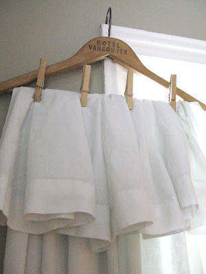 Learn how to create 10 minute dreamy white sheet curtains hung from a vintage hanger. Charming, beautiful and easy!