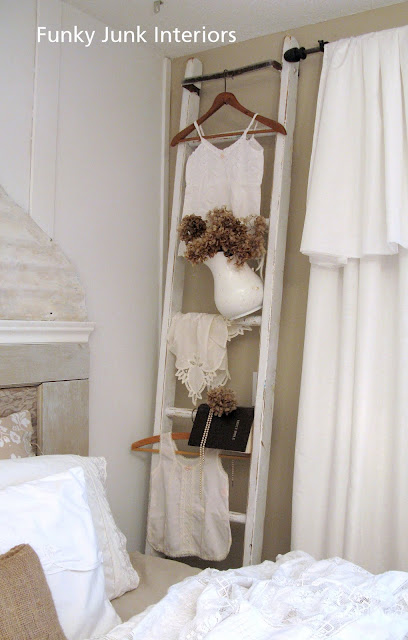 ladder display / A salvaged White Trash bedroom makeover with old door and gate headboard, via FunkyJunkInteriors.net