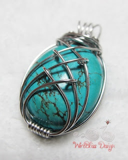a caged turquoise pendant