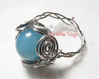 Braided ring with blue stone