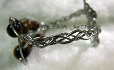 Braided infinity bracelet combining braiding (4 wires) and tiger eyes