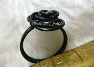 black steel wire rose ring