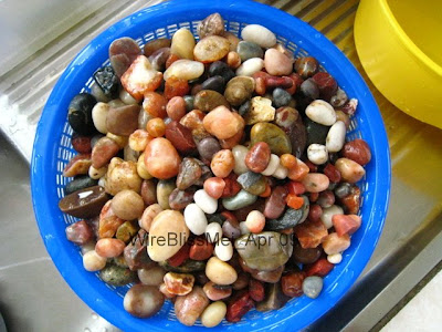 A basket full of colorful river rocks