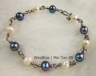wire wrapped blue and white pearl bracelet