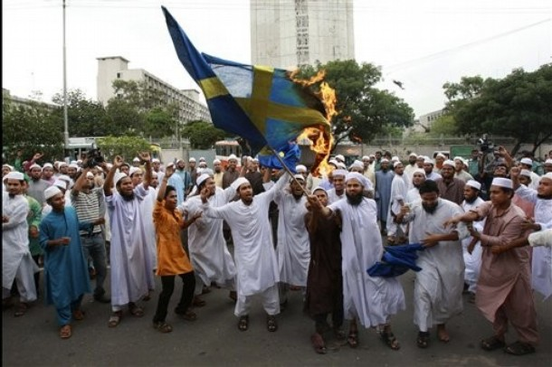 Muslim fanatic burn a Swedish flag in the streets of Stockholm