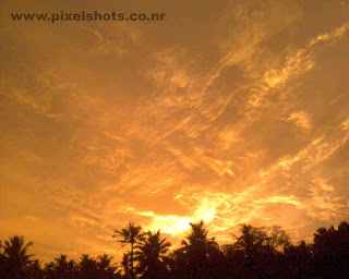 sunset afterglow with cloudy horison,a golden sunset scenery from kerala