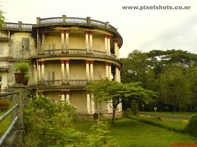 the old palace built in kerala ettukettu architecture style now used as museum for the tourists displaying old weapons arms and chariots used by raja of cochin