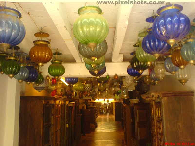 colourful wall lamps or candliers for sale in an antiques shop in cochin jew street of india cochin kerala