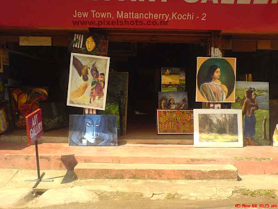 paintings selling shop in mattancherry town of kerala cochin,photograph of oil and ordinary paintings in display infront of shop